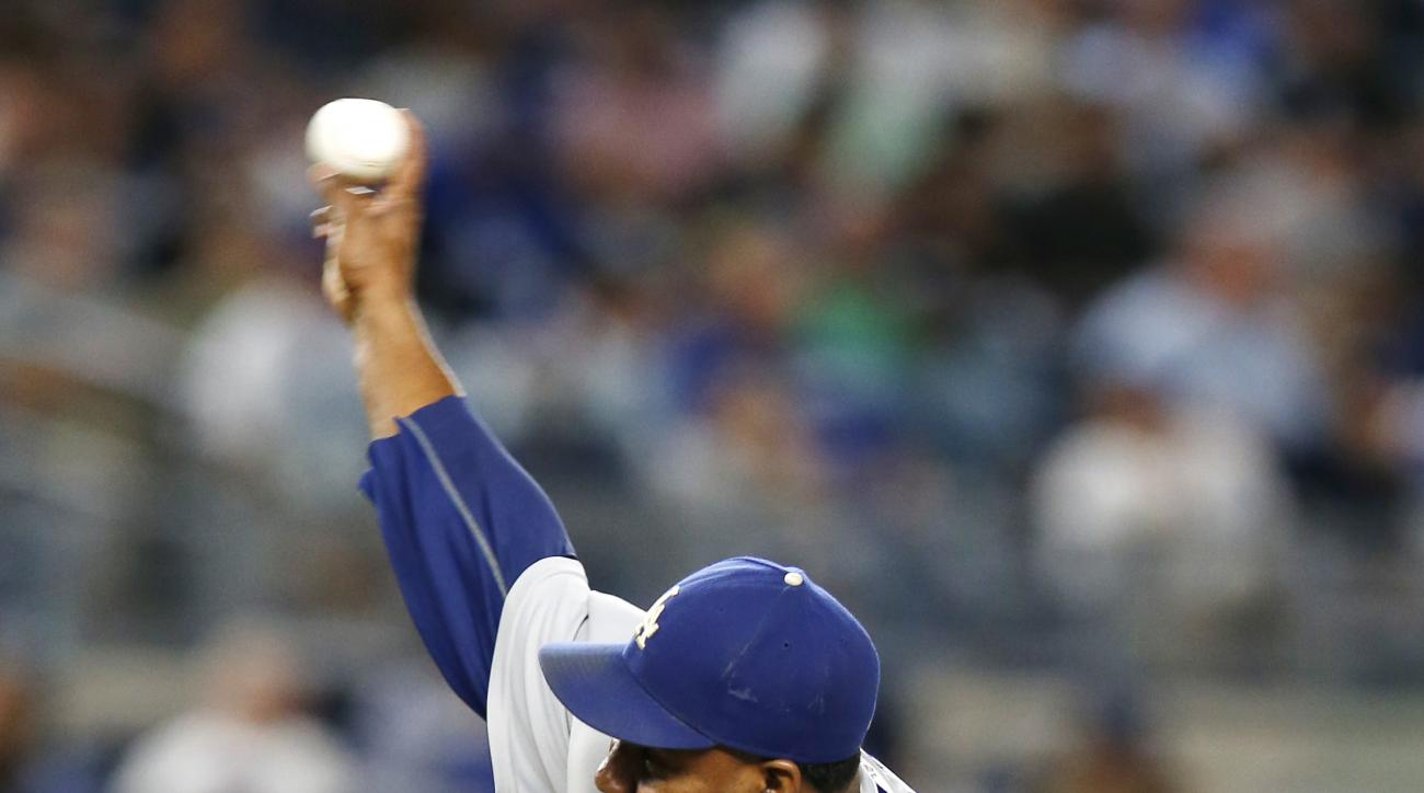 Los Angeles Dodgers' relief pitcher Pedro Baez (52) delivers in the sixth inning of a baseball game against the New York Yankees in New York, Monday, Sept. 12, 2016. (AP Photo/Kathy Willens)