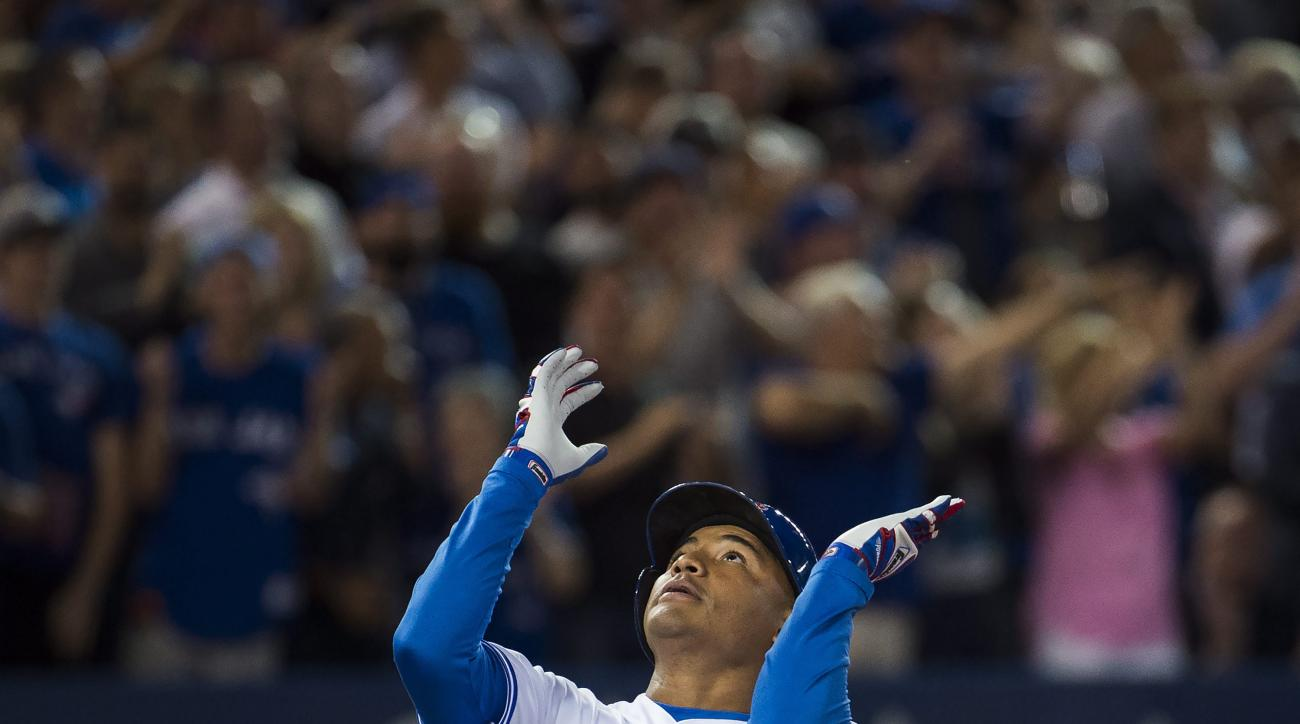 Toronto Blue Jays' Ezequiel Carrera reacts after hitting a solo home run against the Tampa Bay Rays during eighth-inning baseball game action in Toronto, Monday, Sept. 12, 2016. (Nathan Denette/The Canadian Press via AP)