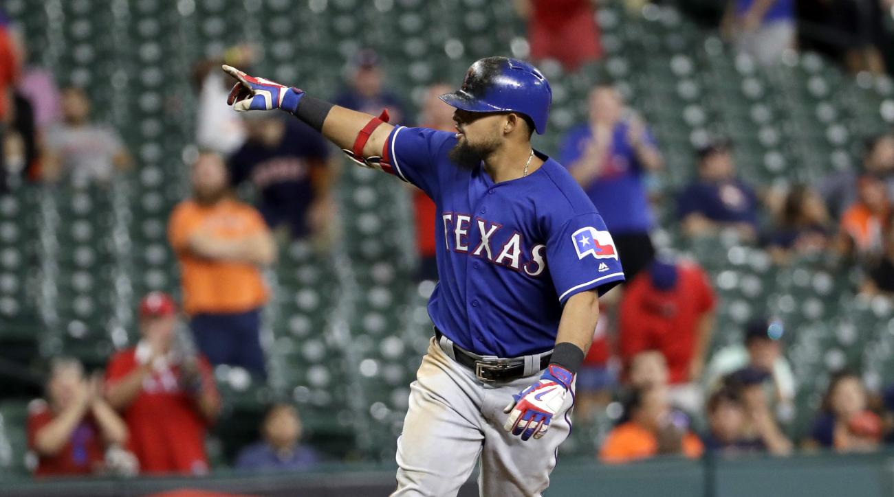 Texas Rangers' Rougned Odor points to the dugout as he runs the bases after hitting a home run against the Houston Astros during the 12th inning of a baseball game Monday, Sept. 12, 2016, in Houston. (AP Photo/David J. Phillip)