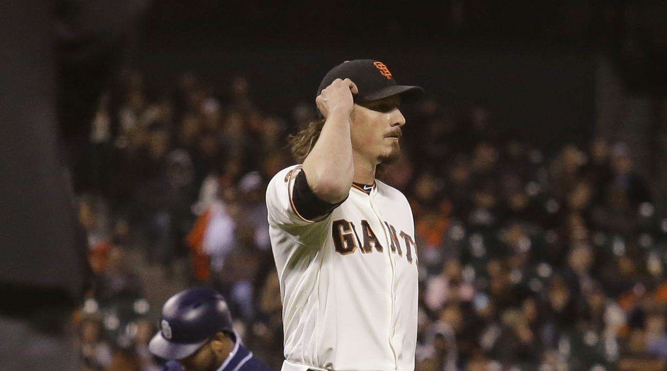 San Francisco Giants starting pitcher Jeff Samardzija, right, walks back to the mound after giving up a two-run home run to the San Diego Padres' Hector Sanchez, left, in the sixth inning of a baseball game Monday, Sept. 12, 2016, in San Francisco. (AP Ph