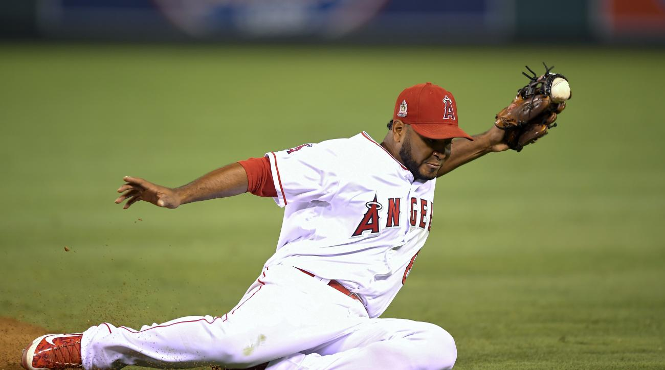 Los Angeles Angels second baseman Gregorio Petit fields a ball hit by Seattle Mariners' Kyle Seager during the seventh inning of a baseball game, Monday, Sept. 12, 2016, in Anaheim, Calif. (AP Photo/Mark J. Terrill)