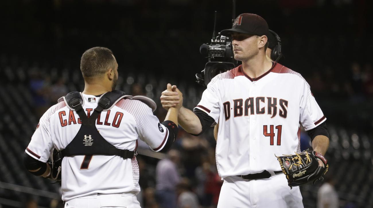 Arizona Diamondbacks pitcher Daniel Hudson (41) greets catcher Welington Castillo (7) after a baseball game against the Colorado Rockies, Monday, Sept. 12, 2016, in Phoenix. The Diamondbacks won 12-9. (AP Photo/Matt York)