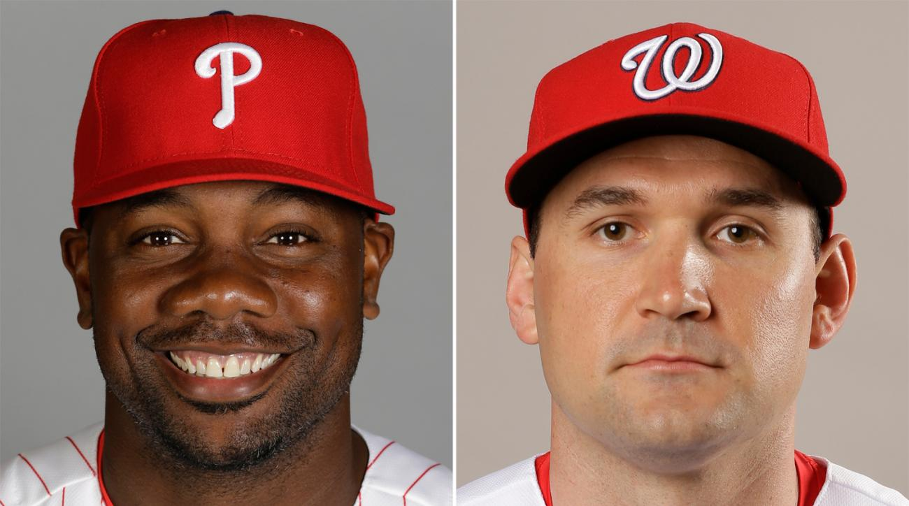 FILE - These are 2016 file photos showing Philadelphia Phillies' Ryan Howard, left, and Washington Nationals' Ryan Zimmerman. Al-Jazeera is asking a judge to dismiss defamation lawsuits filed by two Major League Baseball players over statements made in a