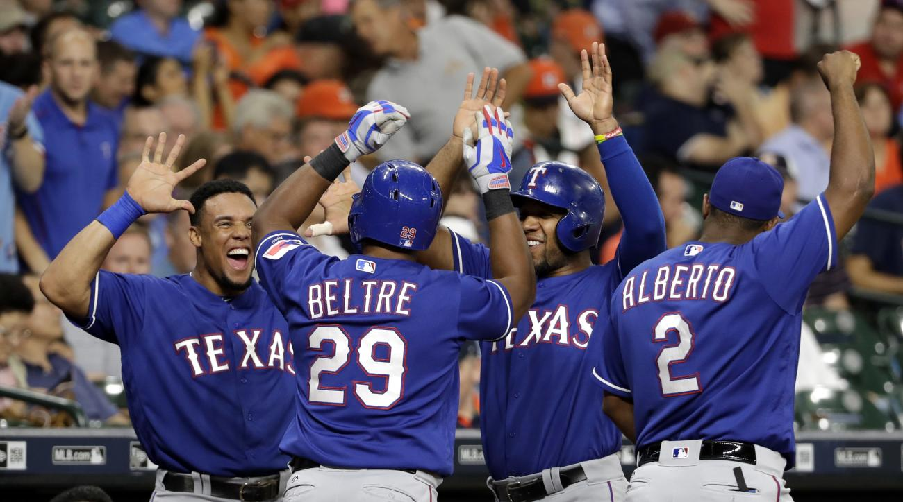 Texas Rangers' Adrian Beltre (29) is congratulated by Carlos Gomez, left, Elvis Andrus and Hanser Alberto (2) after hitting a home run against the Houston Astros during the second inning of a baseball game Tuesday, Sept. 13, 2016, in Houston. (AP Photo/Da