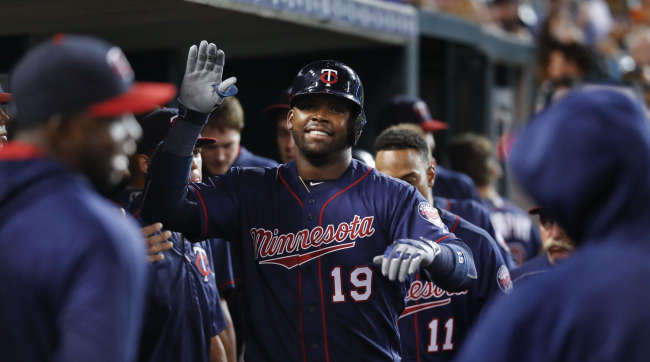 Minnesota Twins' Kennys Vargas (19) celebrates his solo home run against the Detroit Tigers during the ninth inning of a baseball game in Detroit, Tuesday, Sept. 13, 2016. (AP Photo/Paul Sancya)