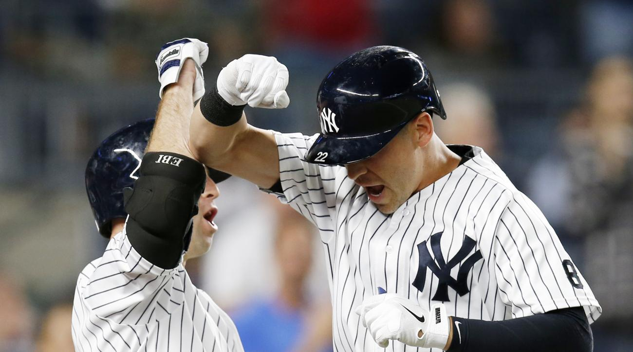 New York Yankees' Brett Gardner, left, celebrates with pinch-hitter Jacoby Ellsbury after Ellsbury' seventh-inning solo home run in New York, Tuesday, Sept. 13, 2016. (AP Photo/Kathy Willens)