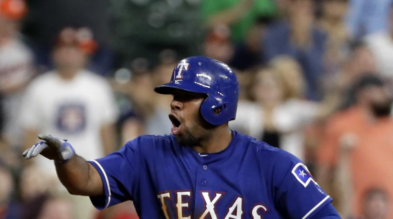 Texas Rangers' Elvis Andrus celebrates after hitting an RBI triple during the ninth inning of a baseball game against the Houston Astros on Tuesday, Sept. 13, 2016, in Houston. (AP Photo/David J. Phillip)