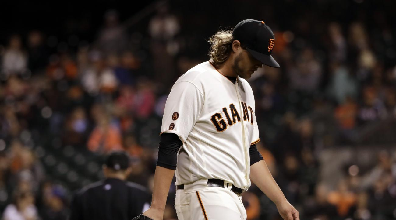 San Francisco Giants relief pitcher Steven Okert walks off the mound after giving up a three-run home run to San Diego Padres' Ryan Schimpf during the ninth inning of a baseball game Tuesday, Sept. 13, 2016, in San Francisco. San Diego won 6-4. (AP Photo/