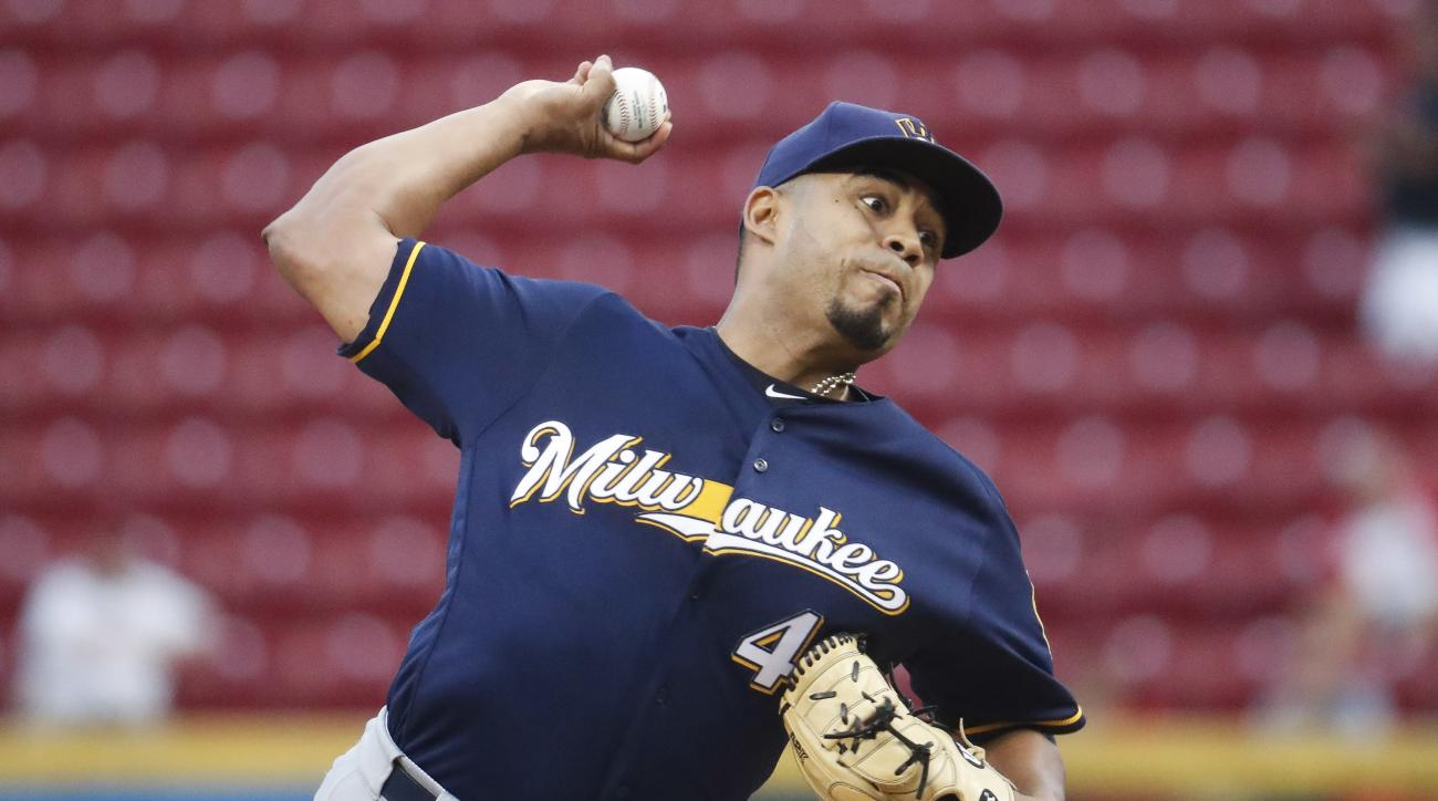 Milwaukee Brewers starting pitcher Junior Guerra throws during the first inning of a baseball game against the Cincinnati Reds, Wednesday, Sept. 14, 2016, in Cincinnati. (AP Photo/John Minchillo)