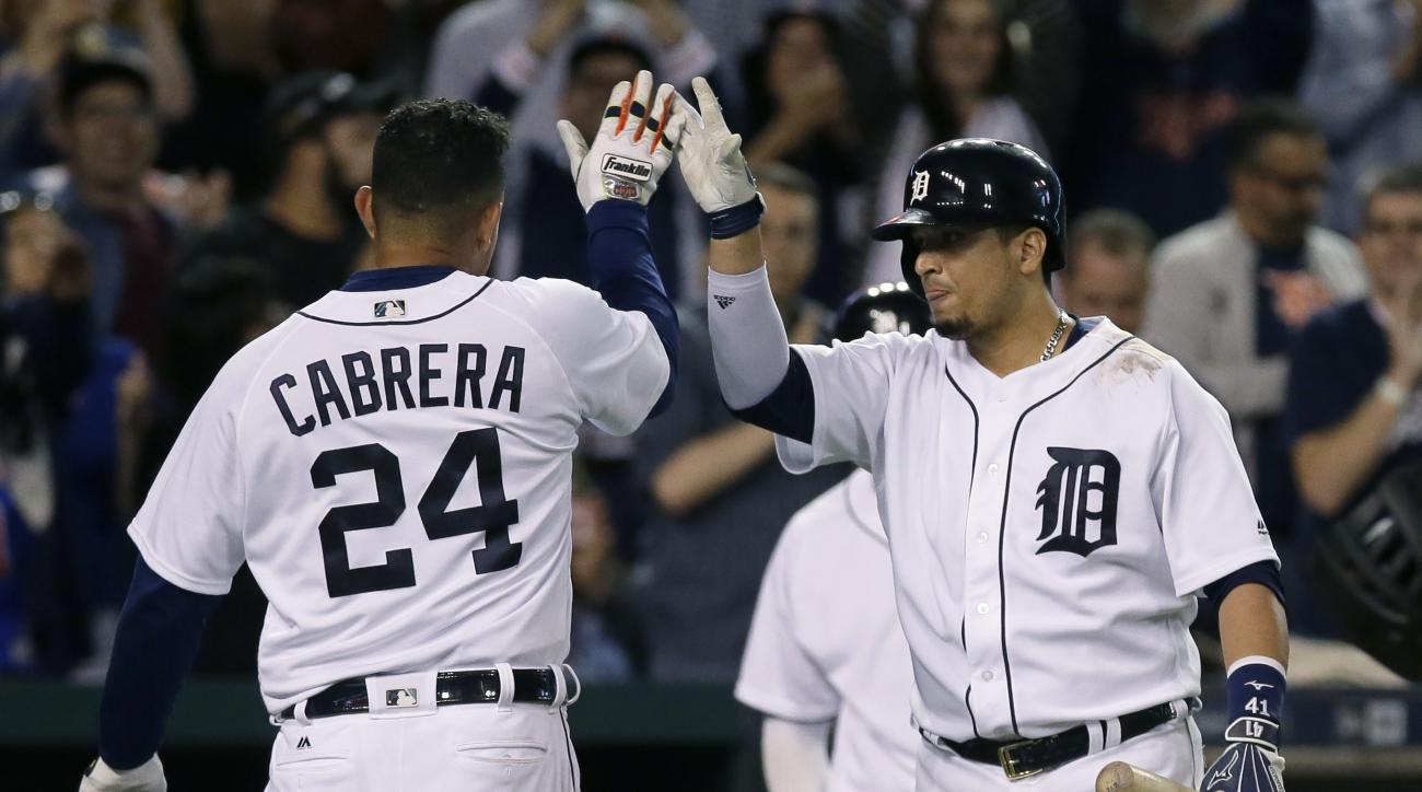 Detroit Tigers' Miguel Cabrera receives a high-five from Victor Martinez after hitting a solo home run against the Minnesota Twins during the seventh inning of a baseball game Wednesday, Sept. 14, 2016, in Detroit. The Tigers defeated the Twins 9-6. (AP P