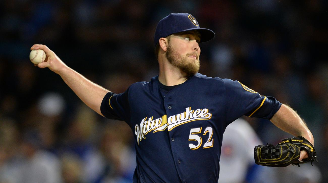 Milwaukee Brewers starter Jimmy Nelson delivers a pitch during the first inning of a baseball game against the Chicago Cubs on Thursday, Sept. 15, 2016 in Chicago. (AP Photo/Paul Beaty)