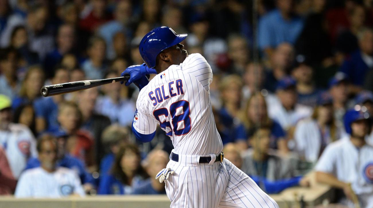 Chicago Cubs' Jorge Soler watches his two-run home run during the second inning of a baseball game against the Milwaukee Brewers on Thursday, Sept. 15, 2016, in Chicago. (AP Photo/Paul Beaty)