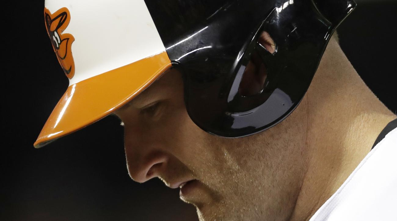 Baltimore Orioles' Mark Trumbo walks off the field after popping out to end the seventh inning of a baseball game against the Tampa Bay Rays in Baltimore, Thursday, Sept. 15, 2016. Tampa Bay won 7-6. (AP Photo/Patrick Semansky)