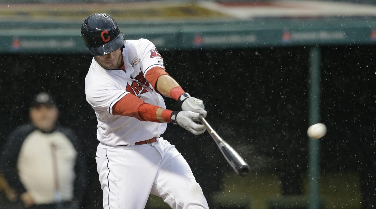 FILE - In this May 14, 2016 file photo, Cleveland Indians' Yan Gomes hits a solo home run off Minnesota Twins relief pitcher Kevin Jepsen in the ninth inning of a baseball game in the rain, in Cleveland. Gomes has a broken bone in his right wrist, likely