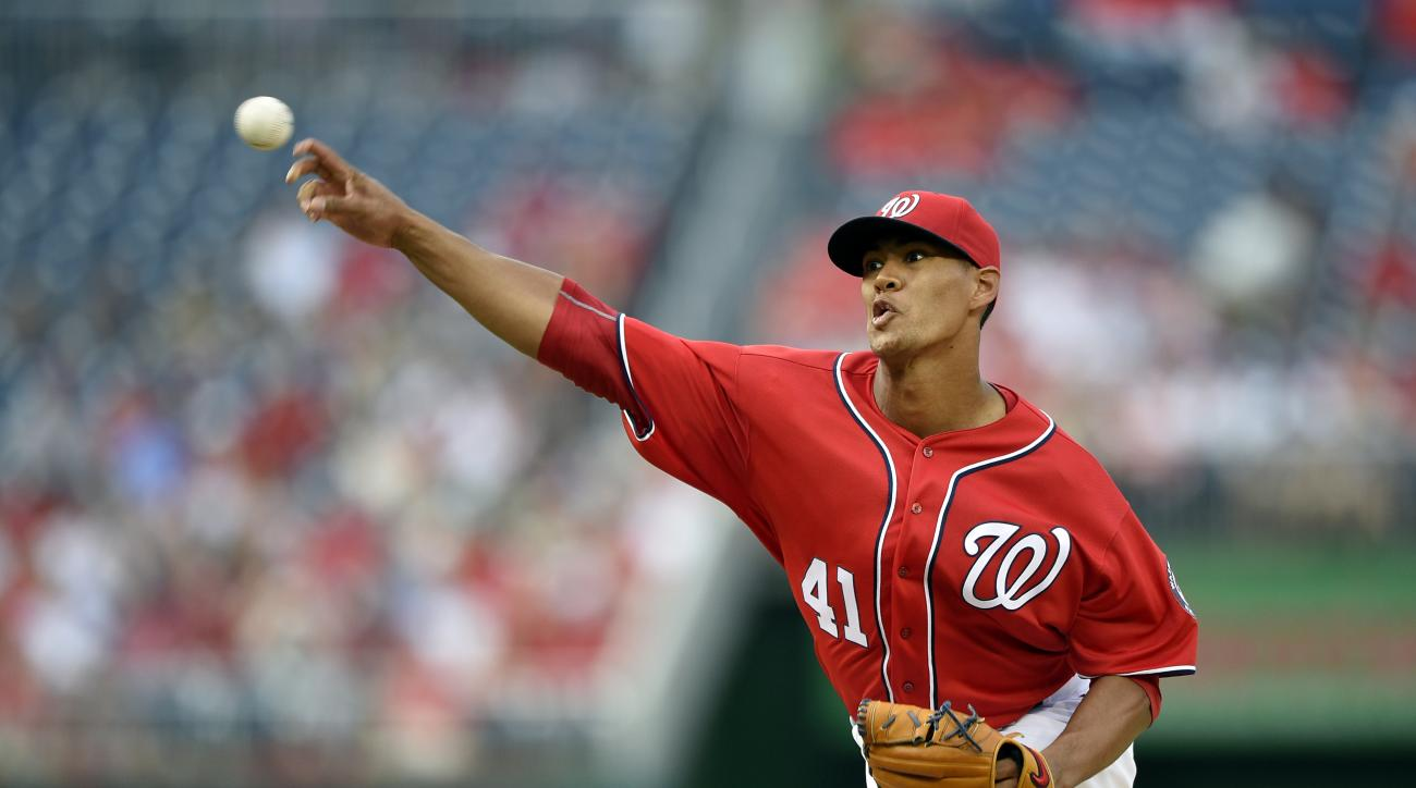 FILE - In this July 2, 2016, file photo, Washington Nationals starting pitcher Joe Ross delivers a pitch during the first inning of a baseball game against the Cincinnati Reds in Washington. Nationals manager Dusty Baker is expecting Ross to return from t