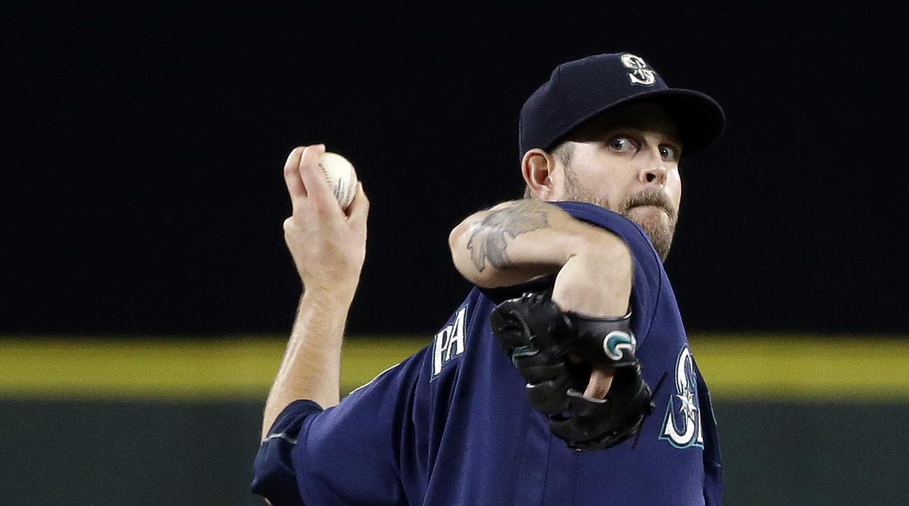 Seattle Mariners starting pitcher James Paxton throws against the Houston Astros during the fifth inning of a baseball game Saturday, Sept. 17, 2016, in Seattle. (AP Photo/Elaine Thompson)