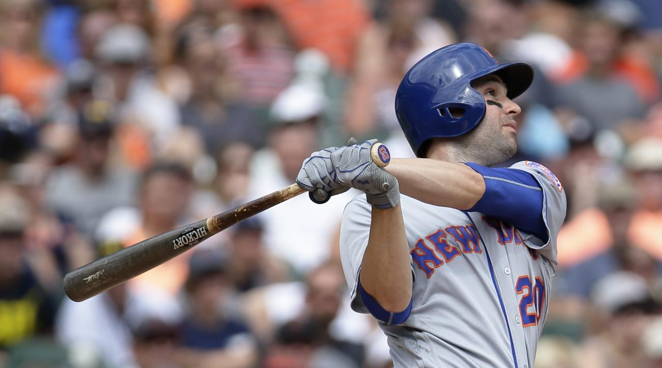 FILE - In this Aug. 7, 2016, file photo, New York Mets' Neil Walker hits a two-run home run to take a 3-1 lead over the Detroit Tigers during the ninth inning of an interleague baseball game, in Detroit. Neil Walker hopes to remain with the New York Mets.