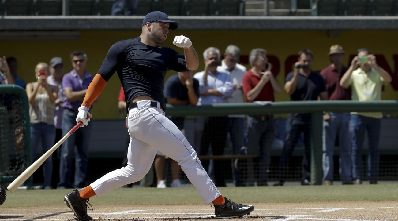 FILE - In this Aug. 30, 2016, file photo, former NFL quarterback Tim Tebow hits during batting practice for baseball scouts and the media during a showcase on the campus of the University of Southern California, in Los Angeles. The 2007 Heisman Trophy win
