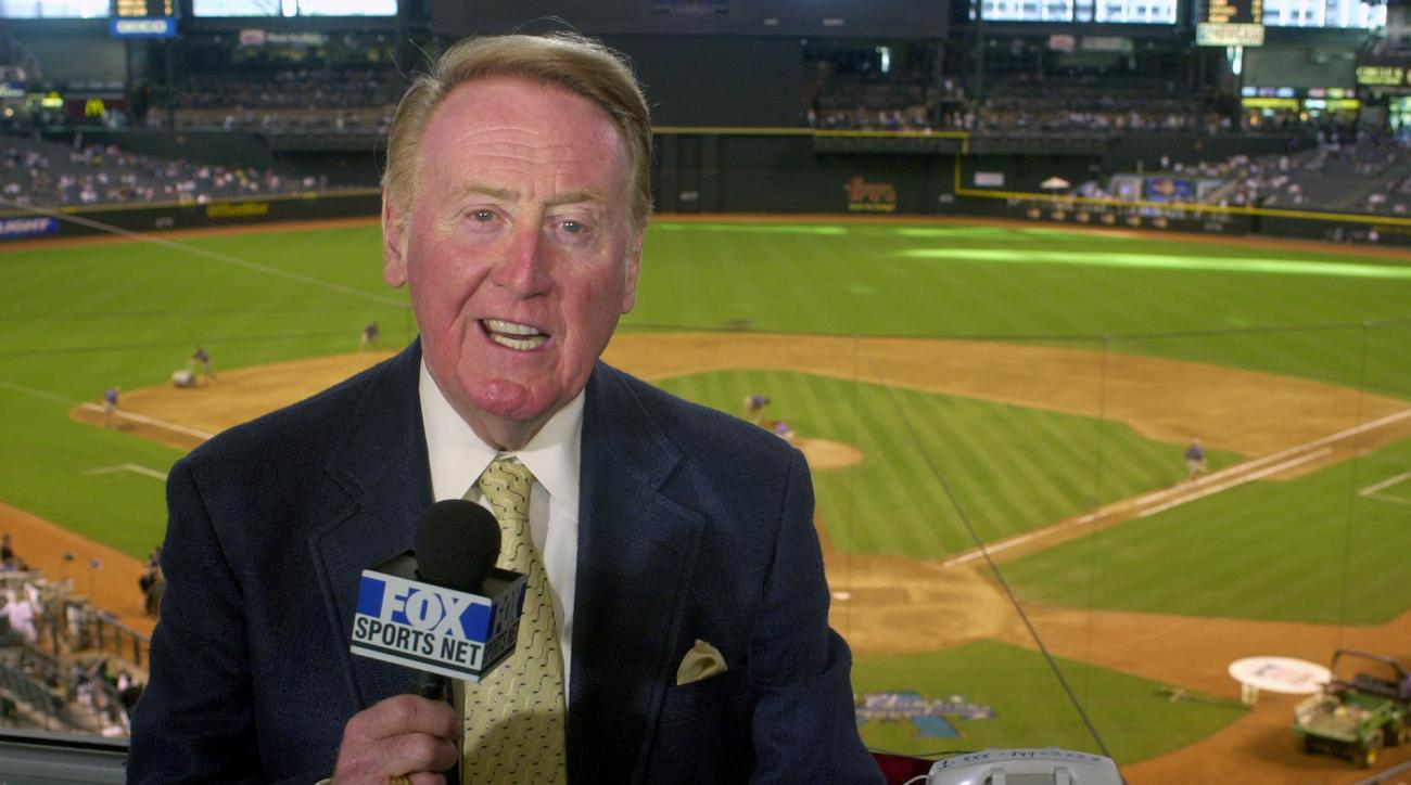 FILE - In this July 3, 2002, file photo,  Los Angeles Dodgers television play-by-play announcer Vin Scully rehearses before a game between the Dodgers and the Arizona Diamondbacks, in Phoenix. Scully begins his final homestand behind the mic for the Los A