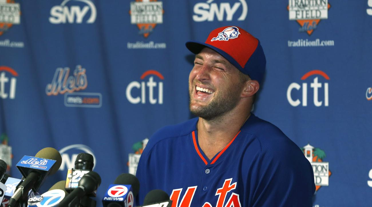 Tim Tebow laughs as he answers questions during a news conference at the New York Mets' complex, Monday, Sept. 19, 2016, in Port St. Lucie, Fla. The 2007 Heisman Trophy winner and former NFL quarterback got to the complex early Monday, and started his fir