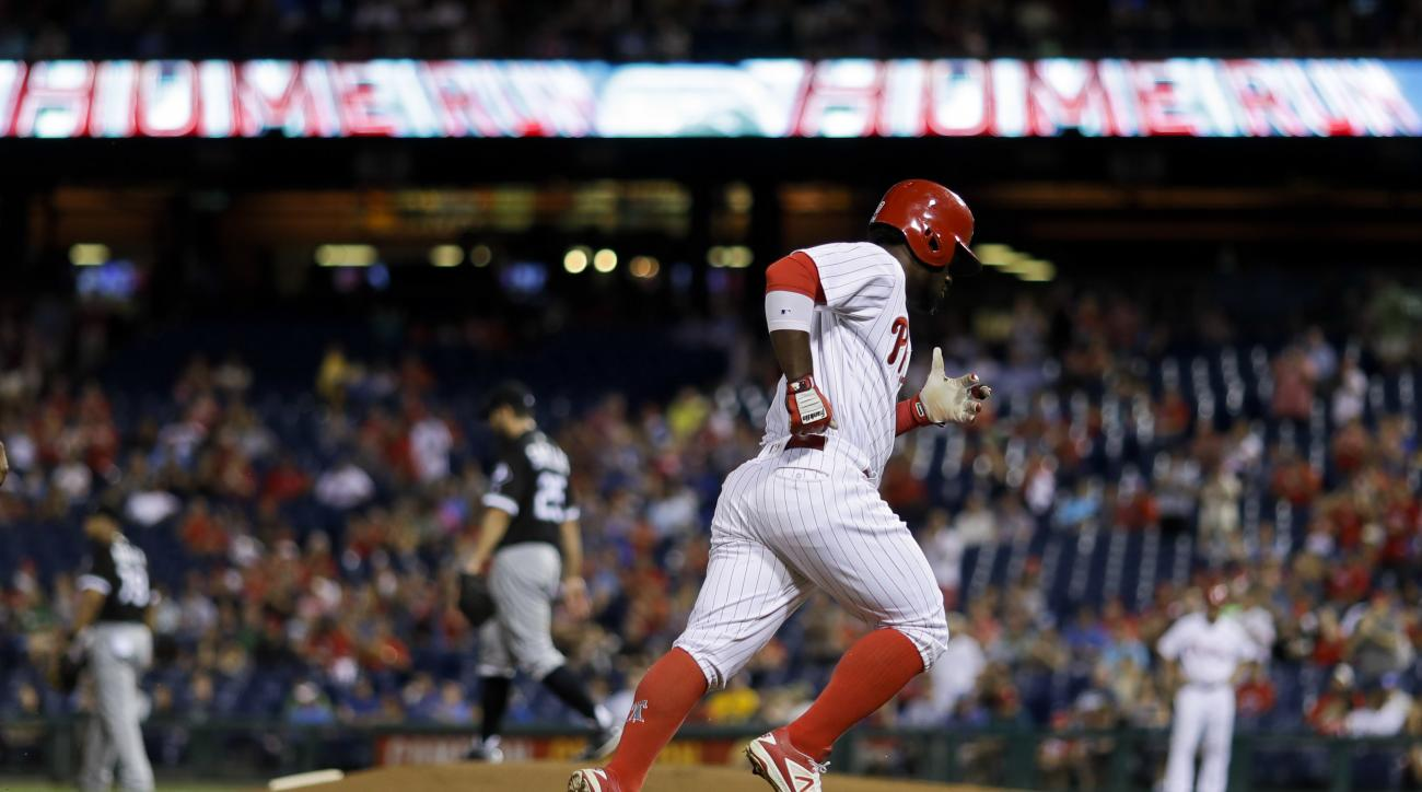 Philadelphia Phillies' Odubel Herrera, right, rounds the bases after hitting a two-run home run off Chicago White Sox starting pitcher James Shields during the first inning of a baseball game, Tuesday, Sept. 20, 2016, in Philadelphia. (AP Photo/Matt Slocu