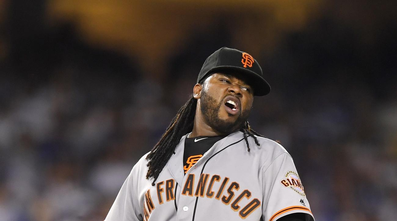 San Francisco Giants starting pitcher Johnny Cueto winces after injuring himself during the sixth inning of a baseball game against the Los Angeles Dodgers, Tuesday, Sept. 20, 2016, in Los Angeles. Cueto was taken out of the game soon after. (AP Photo/Mar