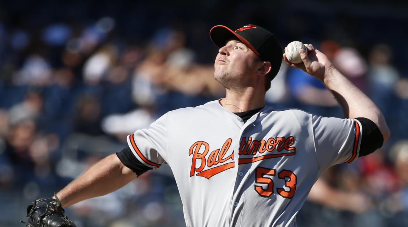 FILE - In this Aug. 28, 2016, file photo, Baltimore Orioles relief pitcher Zach Britton (53) winds up in the ninth inning of the Orioles 5-0 shutout over the New York Yankees in a baseball game in New York. Britton has become part of the conversation for