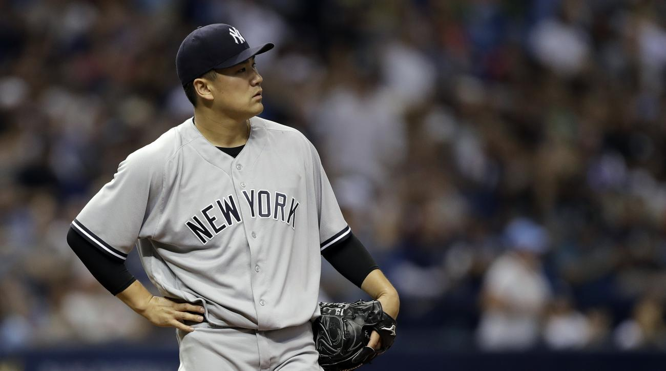 New York Yankees starting pitcher Masahiro Tanaka, of Japan, watches the ball hit by Tampa Bay Rays' Corey Dickerson goes over the wall for a home run during the third inning of a baseball game Wednesday, Sept. 21, 2016, in St. Petersburg, Fla. Tanaka gav