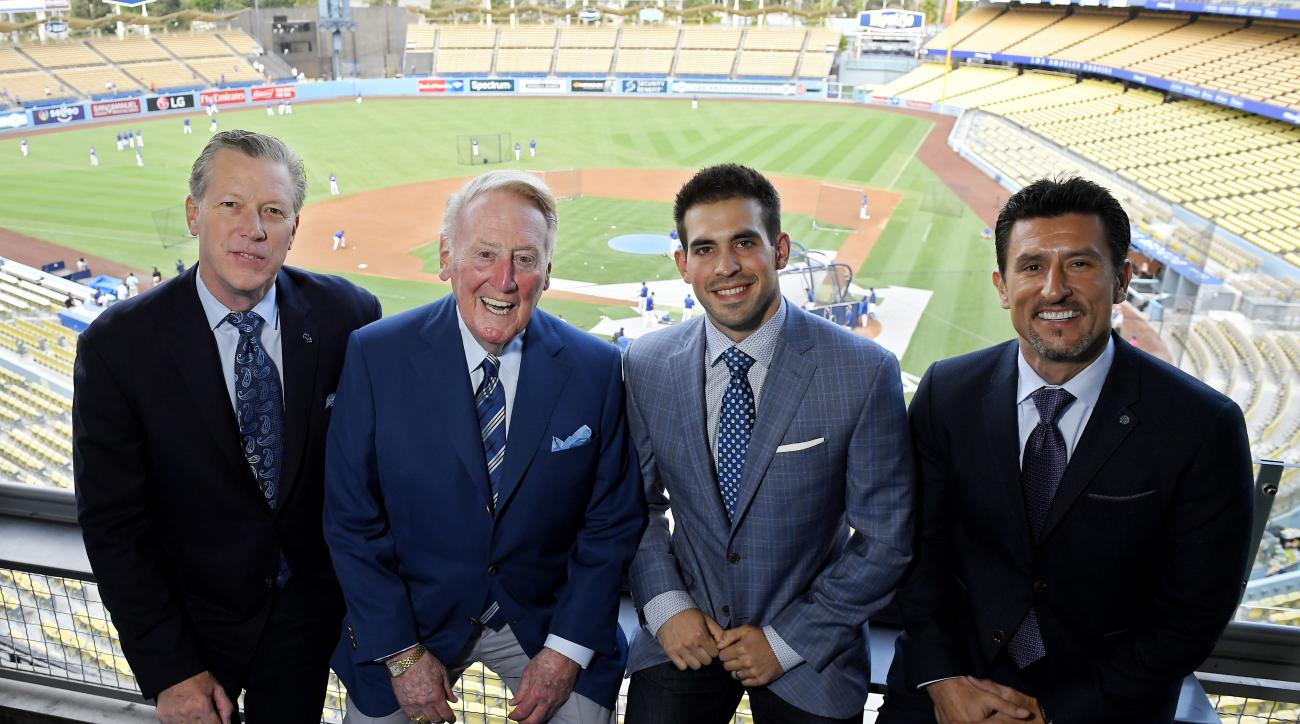 In this Tuesday, Sept. 20, 2016 photo, Dodgers broadcasters, from left, Orel Hershiser, Vin Scully, Joe Davis and Nomar Garciaparra pose prior to a baseball game between the Los Angeles Dodgers and the San Francisco Giants in Los Angeles. As Scully closes