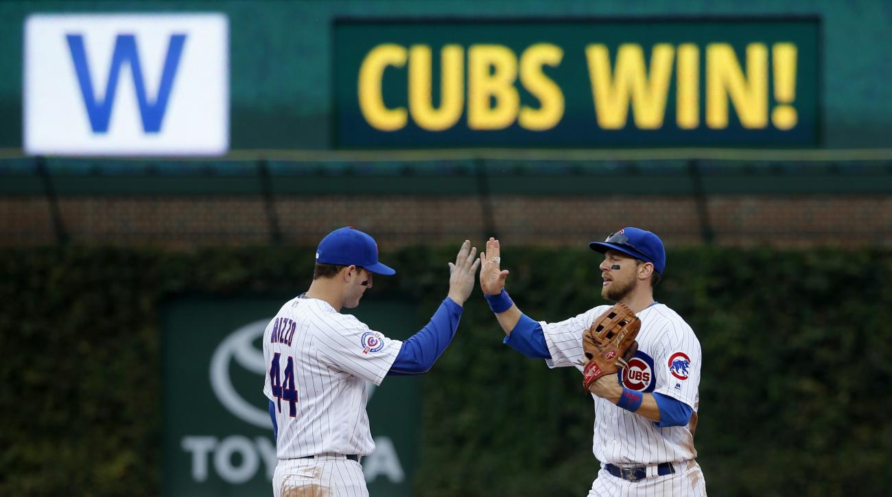 Chicago Cubs' Anthony Rizzo, left, and Ben Zobrist celebrate the Cubs' 5-0 shutout of the St. Louis Cardinals after a baseball game Friday, Sept. 23, 2016, in Chicago. (AP Photo/Charles Rex Arbogast)