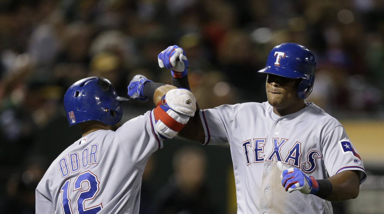 Texas Rangers' Adrian Beltre, right, celebrates with Rougned Odor (12) after hitting a two-run home run against the Oakland Athletics in the seventh inning of a baseball game Friday, Sept. 23, 2016, in Oakland, Calif. (AP Photo/Ben Margot)