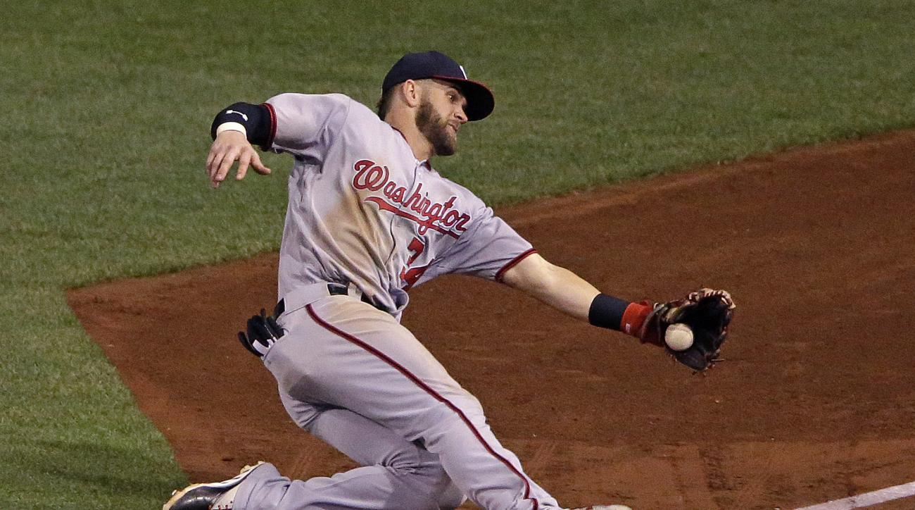 Washington Nationals right fielder Bryce Harper catches a fly ball by Pittsburgh Pirates' Eric Fryer to end the ninth inning of a baseball game in Pittsburgh, Friday, Sept. 23, 2016. The Pirates won in 11 innings, 6-5. (AP Photo/Gene J. Puskar)