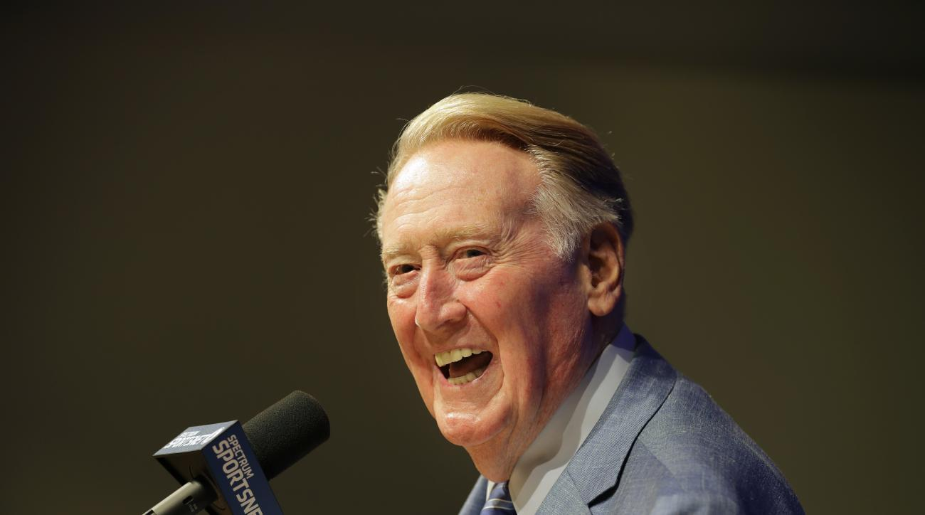 Los Angeles Dodgers broadcaster Vin Scully, who is retiring after the season, smiles as he answers questions from the media during a news conference at Dodger Stadium before a baseball game between the Dodgers and the Colorado Rockies, Saturday, Sept. 24,