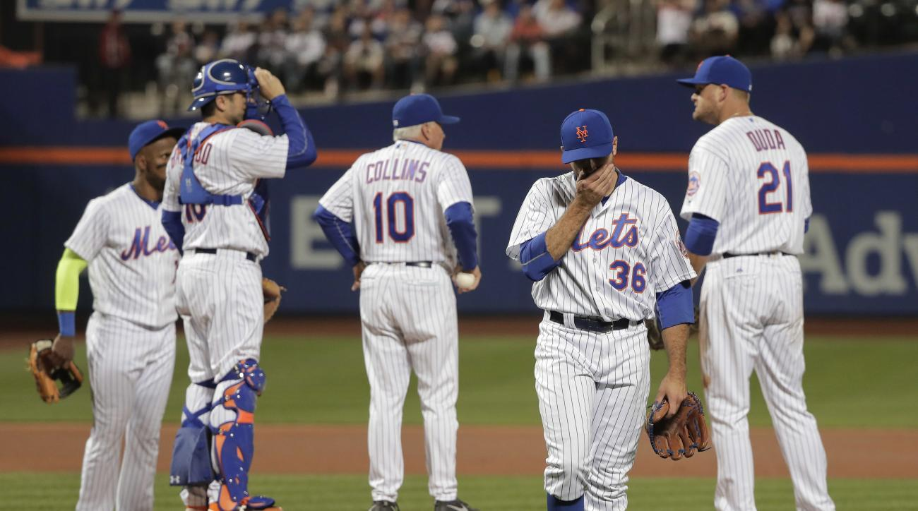 New York Mets pitcher Sean Gilmartin (36) walks off the field after being removed by manager Terry Collins (10), having given up five runs to the Philadelphia Phillies during the first inning of a baseball game, Saturday, Sept. 24, 2016, in New York. (AP