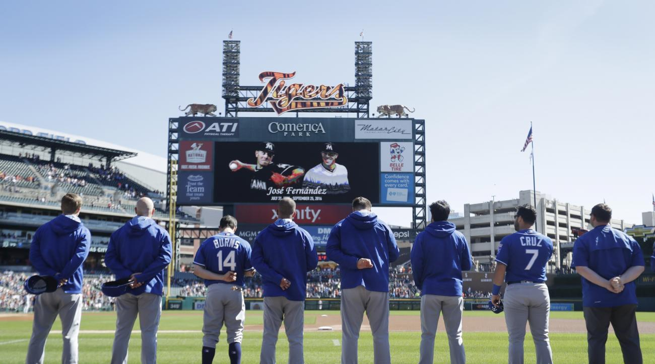 Members of the Kansas City Royals stand during a moment of silence to Miami Marlins pitcher Jose Fernandez before the baseball game against the Detroit Tigers, Sunday, Sept. 25, 2016, in Detroit. Fernandez was killed Sunday morning after a boat crash in M