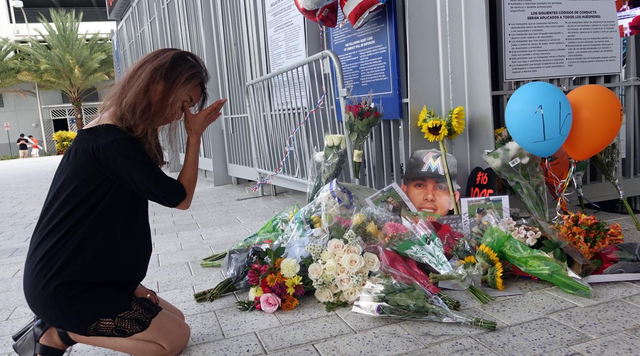 Junko Sasaki of Japan cries at a memorial for Jose Fernandez at Marlins Park in Miami after the game against the Atlanta Braves was canceled because of the death of  pitcher Jose Fernandez, Sunday, Sept. 25, 2016, in Miami Beach. (Joe Cavaretta/South Flor