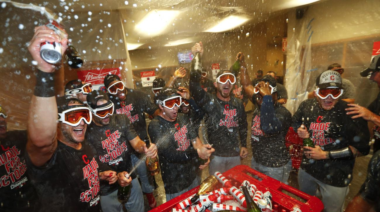 Cleveland Indians celebrate after defeating the Detroit Tigers 7-4 in a baseball game in Detroit, Monday, Sept. 26, 2016. The Indians clinched the AL Central. (AP Photo/Paul Sancya)