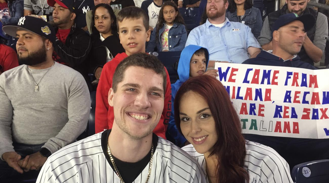 Andrew Fox, left, and Heather Terwilliger sit in the stands at Yankee Stadium on Tuesday night, Sept. 27, 2016, in New York. When Fox pulled the ring from his pocket and dropped to one knee before Terwilliger to propose during the fifth inning of the Yank