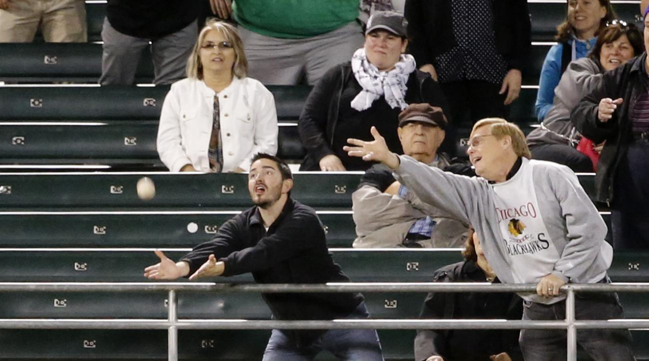 Tampa Bay Rays' Mikie Mahtook and a fan are unable to catch Chicago White Sox's Leury Garcia's three run home run during the third inning of a baseball game Tuesday, Sept. 27, 2016, in Chicago. Alex Avila and Carlos Sanchez also scored on the play. (AP Ph