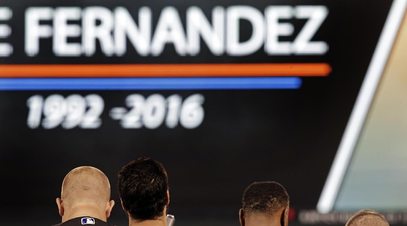 Colorado Rockies including Darin Everson, left, observe a moment of silence for Miami Marlins' pitcher Jose Fernandez prior to a baseball game against the San Francisco Giants, Tuesday, Sept. 27, 2016, in San Francisco. Fernandez was killed in a boating a