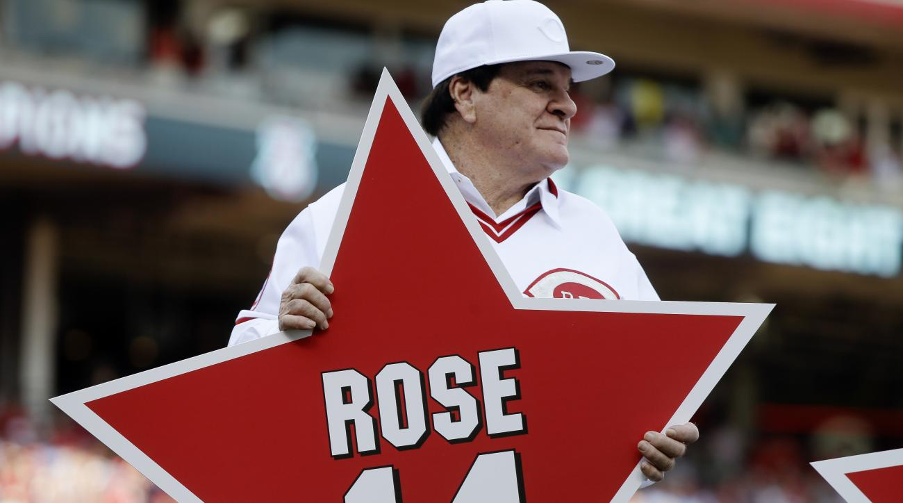 FILE - In this June 24, 2016, file photo, former Cincinnati Reds player Pete Rose holds his place marker during a ceremony to honor the 1976 World Series champion team, before the Reds' baseball game against the San Diego Padres in Cincinnati.  Rose has a