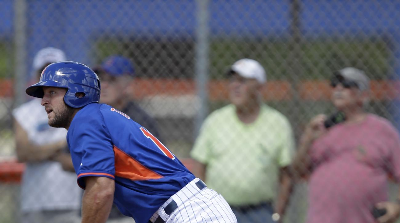 Tim Tebow watches his solo home run in his first at bat during the first inning of  his first instructional league baseball game for the New York Mets against the St. Louis Cardinals instructional club Wednesday, Sept. 28, 2016, in Port St. Lucie, Fla.  (
