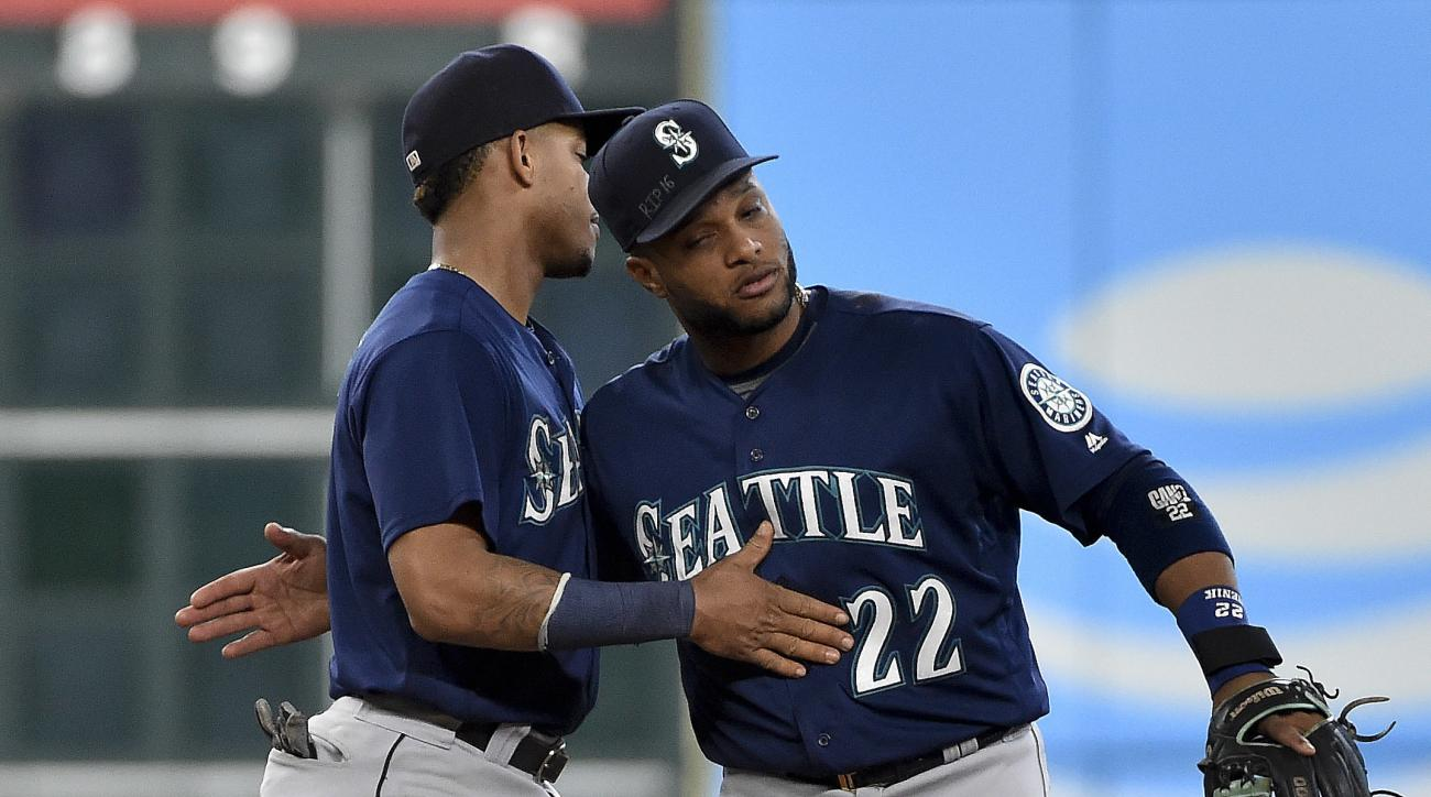 Seattle Mariners' Robinson Cano (22) and Ketel Marte celebrate their 12-4 victory over the Houston Astros in a baseball game, Wednesday, Sept. 28, 2016, in Houston. (AP Photo/Eric Christian Smith)