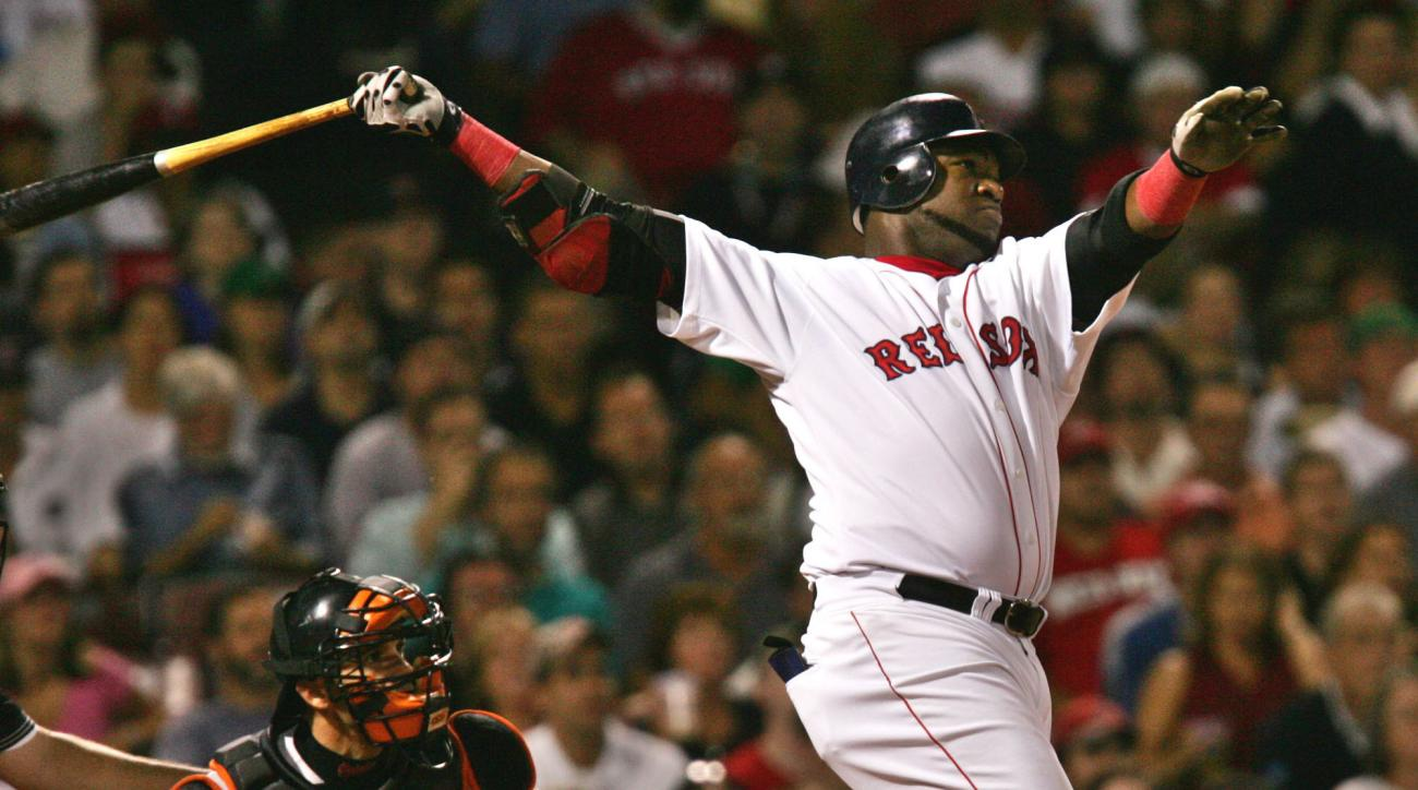 FILE - In this Sept. 22, 2004, file photo, Boston Red Sox's David Ortiz watches the flight of his two run, home run off Baltimore Orioles starter Sidney Ponson, in the seventh inning at Fenway Park in Boston. Ortiz transformed the Boston Red Sox from a cu