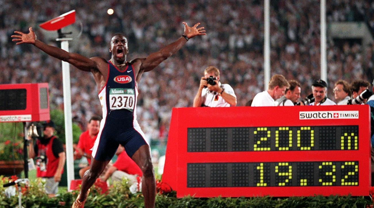 ADVANCE FOR SATURDAY, OCT. 1 - In this Aug. 1, 1996, file photo, Michael Johnson, of the United States, celebrates after he won the men's 200 meter final in a world record time of 19.32 at the 1996 Summer Olympic Games in Atlanta. Turner Field began its b