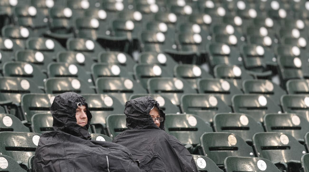 Detroit Tigers fans sits in the stands during a rain delay before a baseball game against the Cleveland Indians in Detroit, Thursday, Sept. 29, 2016. (AP Photo/Paul Sancya)