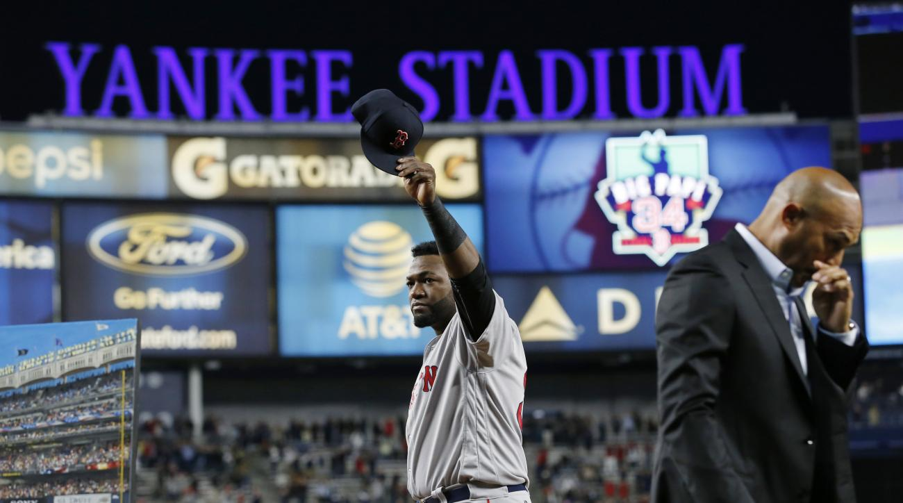 Boston Red Sox designated hitter David Ortiz waves his cap to the crowd as retired New York Yankees pitcher Mariano Rivera walks away, right, after Ortiz was honored before a baseball game between the Yankees and the Red Sox in New York, Thursday, Sept. 2