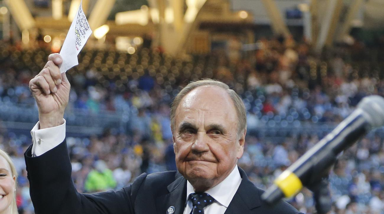 San Diego Padres broadcaster Dick Enberg waves to crowd at a retirement ceremony prior to the Padres final home baseball game of the season, against the Los Angeles Dodgers on Thursday, Sept. 29, 2016, in San Diego. (AP Photo/Lenny Ignelzi)