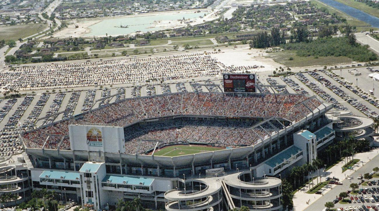 FILE- This  April 5, 1993, file photo, shows an aerial view of Joe Robbie Stadium during the Florida Marlins home opener, in Miami, Fla. Known originally as Joe Robbie Stadium and built mainly for the NFL's Miami Dolphins, it was designed so minimal renov