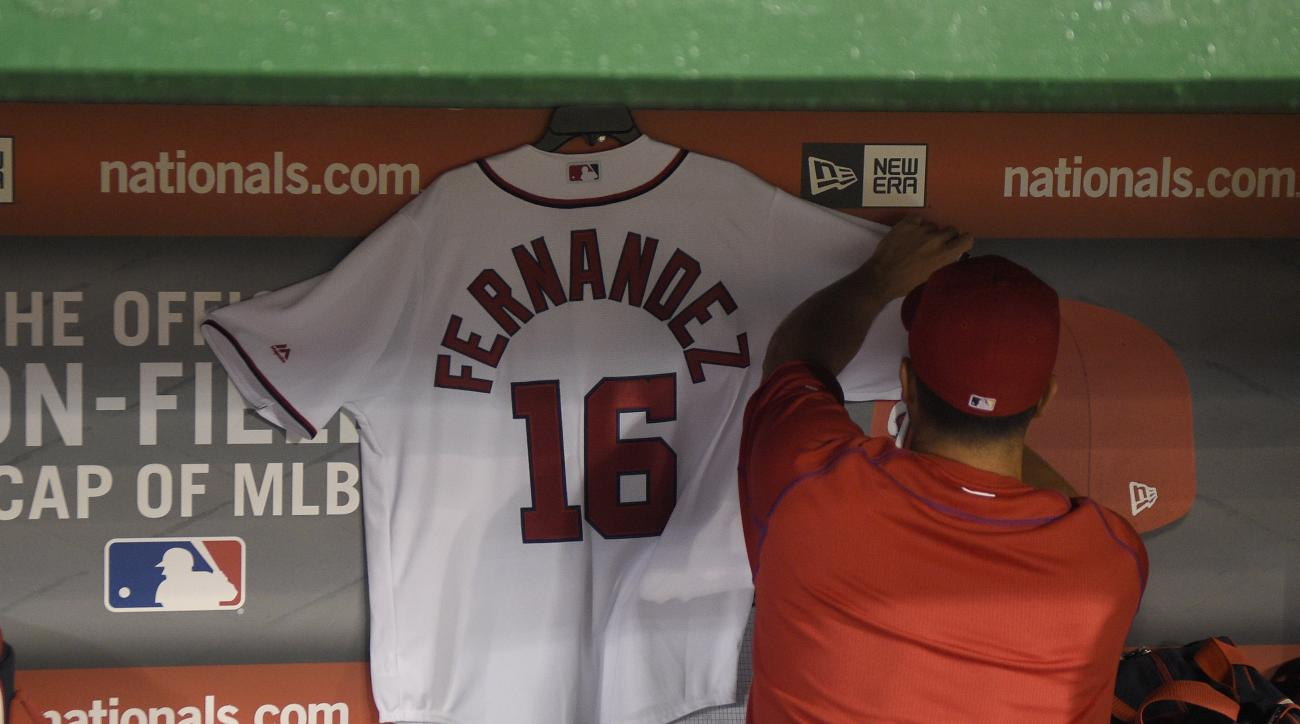 Washington Nationals' Gio Gonzalez hangs a No. 16 jersey in tribute to the late Jose Fernandez, of the Miami Marlins, in the dugout before a baseball game between the teams Friday, Sept. 30, 2016, in Washington. (AP Photo/Nick Wass)